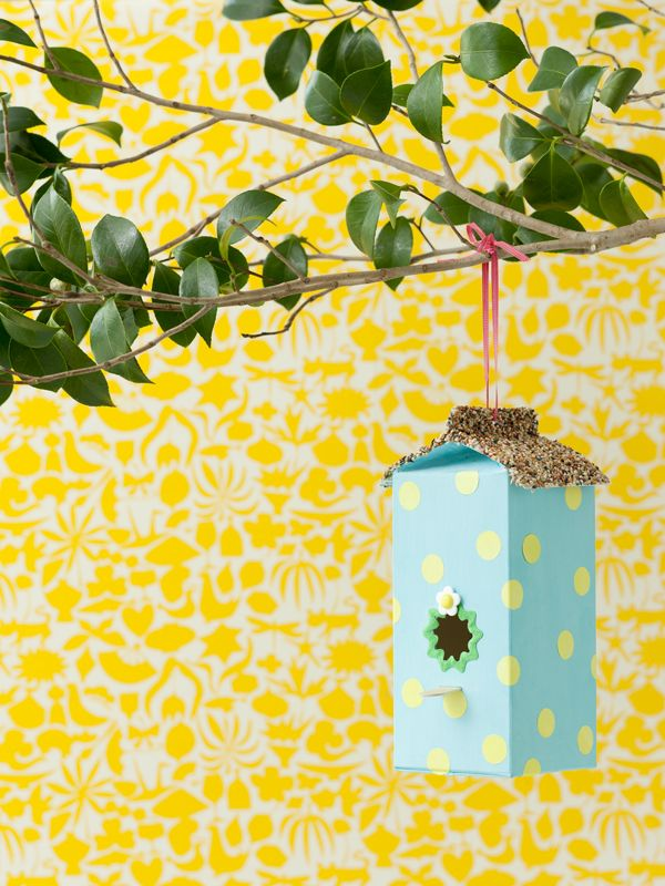 Welcome spring with this DIY Milk Carton Birdhouse Feeder craft.