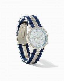 Elegant, two-toned watch, chunky, silicone striping, rhinestone detail. Comes in white and rose gold, black and gold, black and rose gold, navy and silver. Classic chronograph feature.