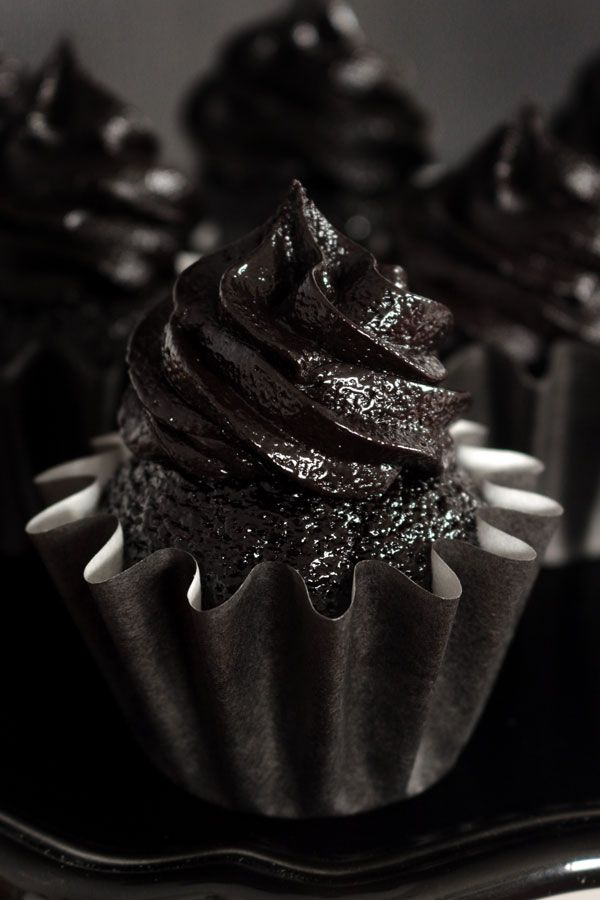 The darkest chocolate cupcake recipe ever! These sweet and sexy cupcakes are a crowd pleaser every time!