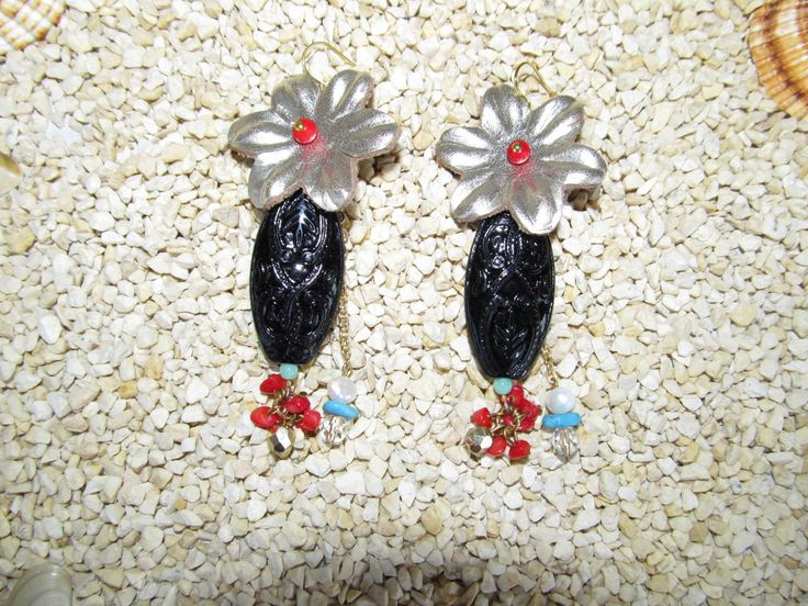 Handmade earrings (1 pair)  Made with leather flowers, black plastic embossed beads, gemstones and glass beads.