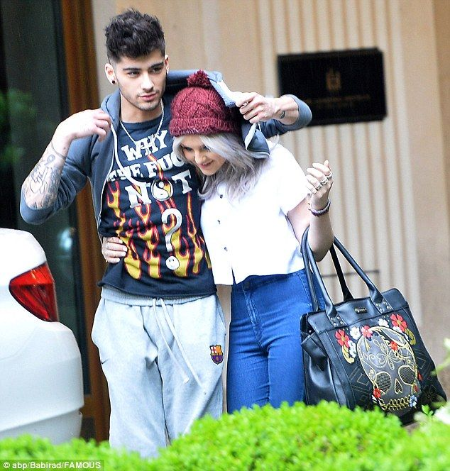 Awww such a gentleman! A protective Zayn Malik holds out his hoodie for girlfriend Perrie Edwards at the slightest hint of drizzling. The cute couple was spotted in Germany as One Direction continue on their Take Me Home tour. via dailymail.co.uk
