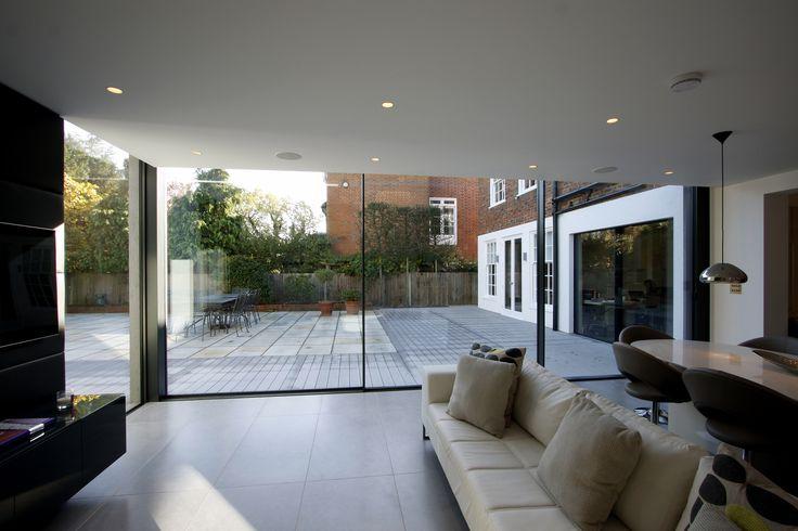 internal view of rear extension using minimal windows sliding doors as frameless access to garden www.iqglassuk.com
