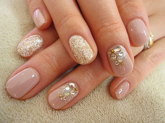 Nude, glitter and crystal nail art