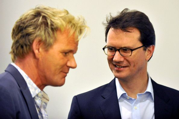"""Gordon Ramsay Gordon Ramsay and Head of Fox Television Peter Rice chat at the Launch of Gordon Ramsay's """"One Potato Two Potato Inc"""" production company on March 18, 2010 in Beverly Hills, California."""