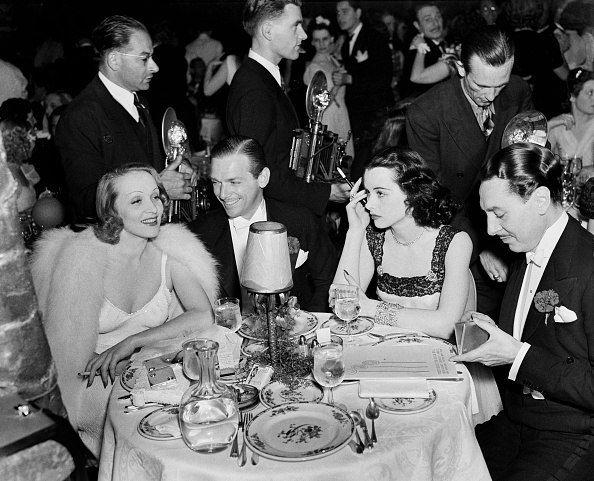 Marlene Dietrich, Douglas Fairbanks Jr, Hedy Lamarr and Reginald Gardiner dining at the Cocoanut Grove, 1938