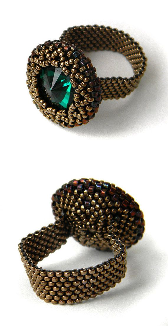 Beaded ring made of Japanese seed beads with emerald Swarovski crystal.  Band width - 6 mm Beaded crystal diameter - 23 mm (0.9) Size - 8 1/2 (US)