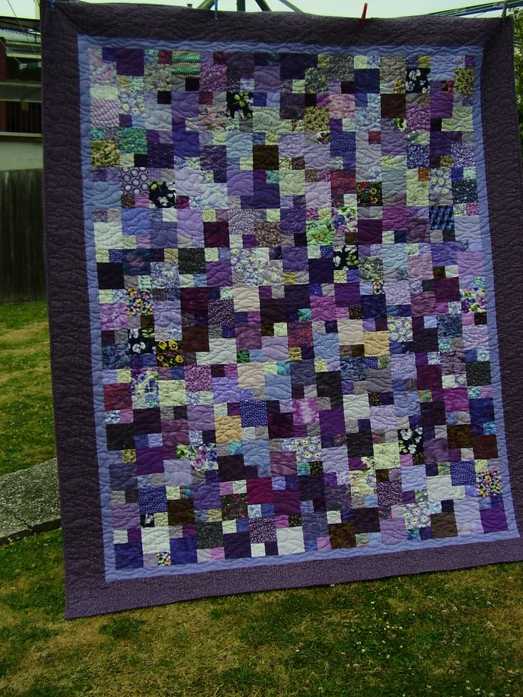 Purple's not my favorite but  I really like this quilt.  Made by a quilter in Tasmania.  Pattern from Freda's Hive.