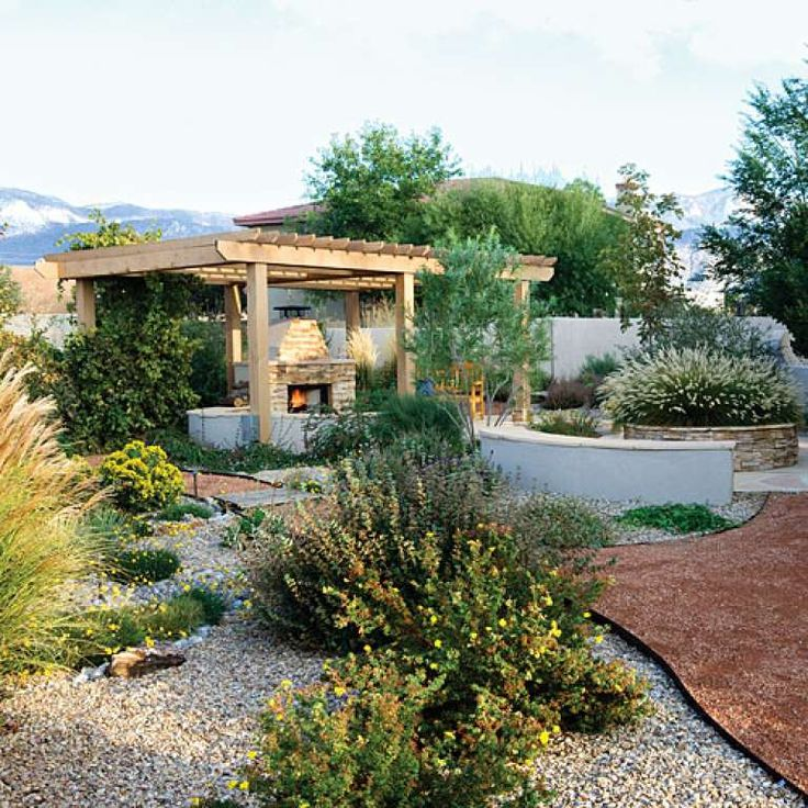 Big on features, not on grass Bridges, islands, and a shaded fireplace add plenty of whimsical details to this Albuquerque backyard—no water necessary. And a smattering of carefully chosen drought-resistant plants offer just enough no-fuss greenery to create a lush feel. Read more: Southwestern garden escape  Photo: Steven A. Gunther, Sunset.com