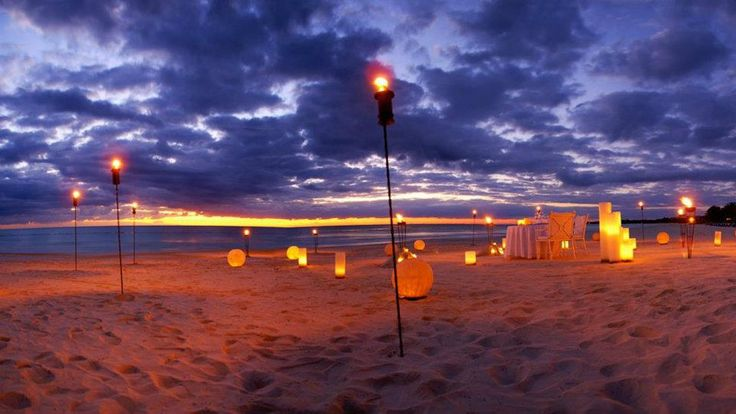 Have dinner on the beach with beautiful lights