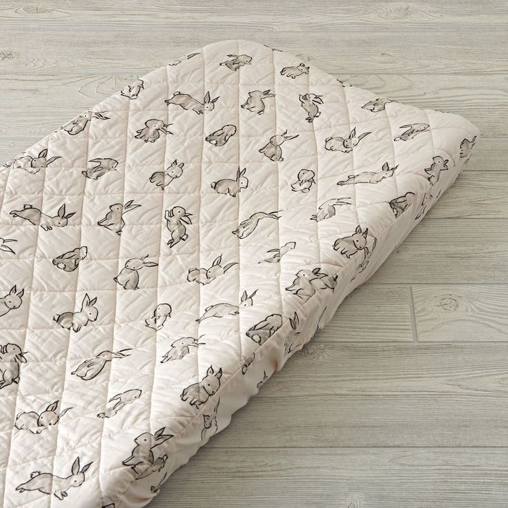 Shop Bunny Changing Pad Cover.  It's time to hop on a Bunny Crib Bedding set like no other.  The light pink crib fitted sheet set is adorned with printed rabbits for a playful touch.