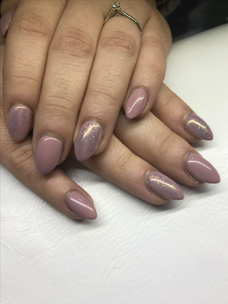 Pinky nude and glare flare glitter on sculpted acrylics