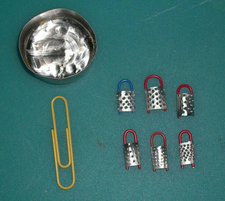 Make a grater from a paper clip and foil.
