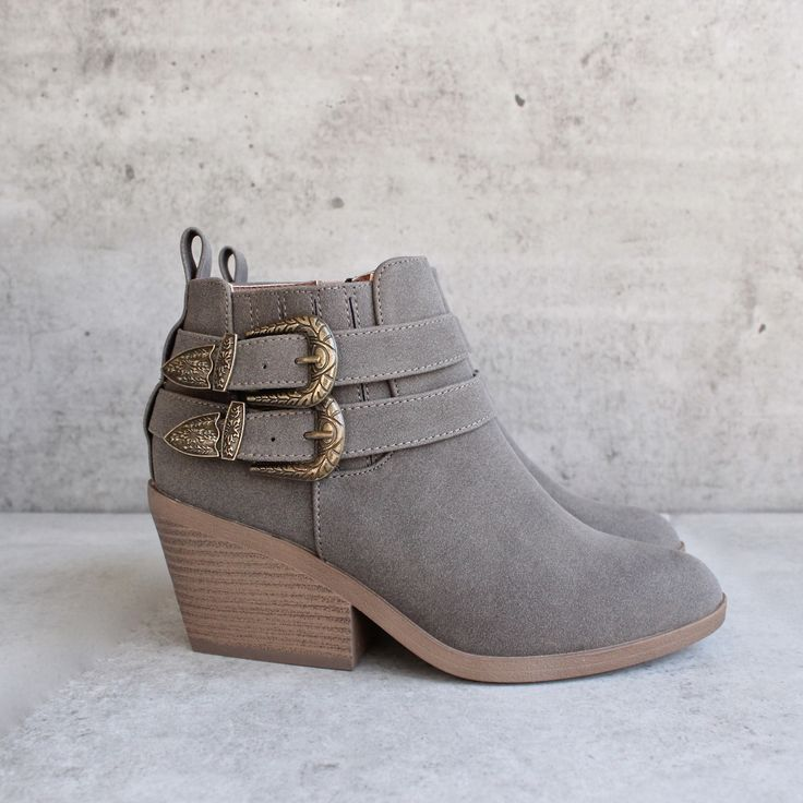 """Vegan nubuck is formed to these stylish almond toe booties with adjustable antiqued silver buckles at the outstep, and goring for fit. 4"""""""" zipper at the instep."""