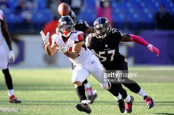 Wide receiver Eric Weems #14 of the Atlanta Falcons catches a pass past inside linebacker C.J. Mosley #57 of the Baltimore Ravens in the second half at M&T Bank Stadium on October 19, 2014 in Baltimore, Maryland.