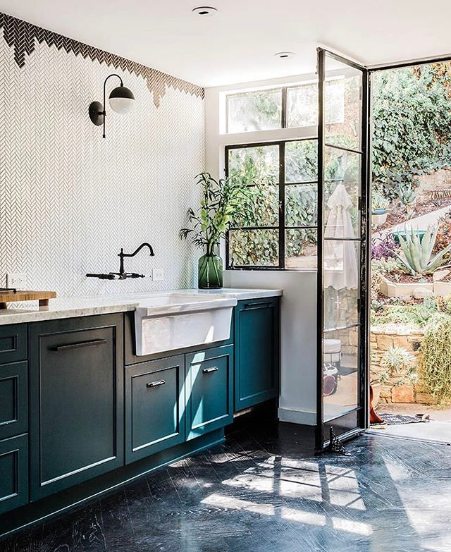 Open kitchen with printed tile and turquoise green painted cabinets