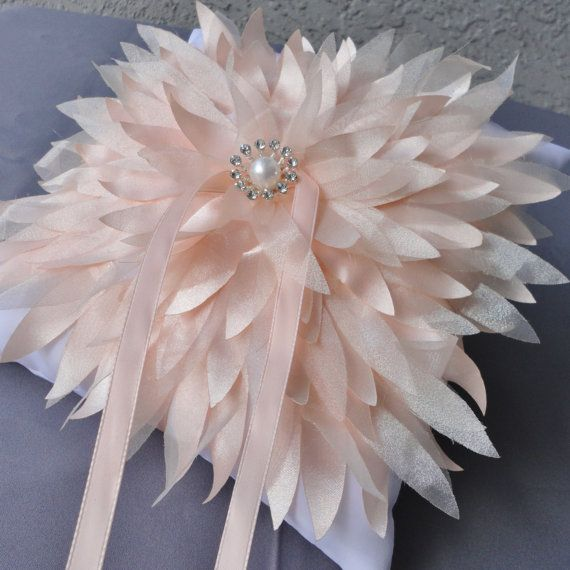 One Of A Kind Wedding Big Peach Color Chrysanthemum On A White Ring Bearer Pillow. $36.00, via Etsy.