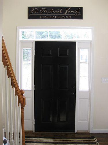 Black inside front door. Like the sign above door.