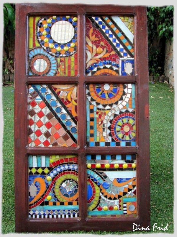 Mosaic tile in an old window frame...Love it!