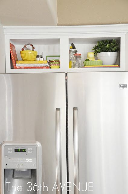 What a fabulous idea for that little cabinet above the fridge that's too high to really conveniently store any thing!  Love it!