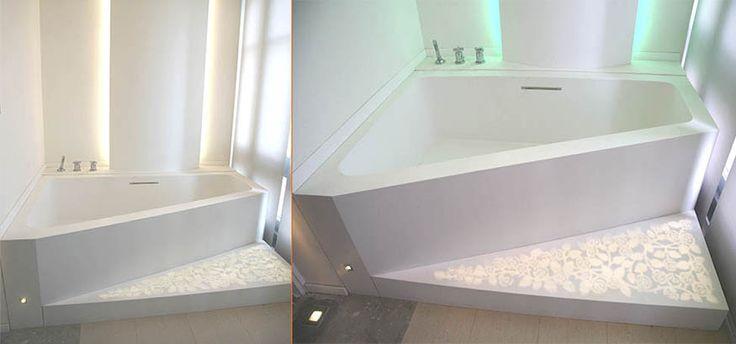 Bañera a medida realizada en LG Hi-Macs® con detalles de retroiluminación en el suelo y forrado de paredes.