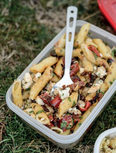 This tasty Mediterranean-inspired pasta salad with feta, peppers and hazelnuts from Genevieve Taylor's How To Eat Outside is a perfect lunch dish that will keep you going for hours and is great for warm-weather adventures.