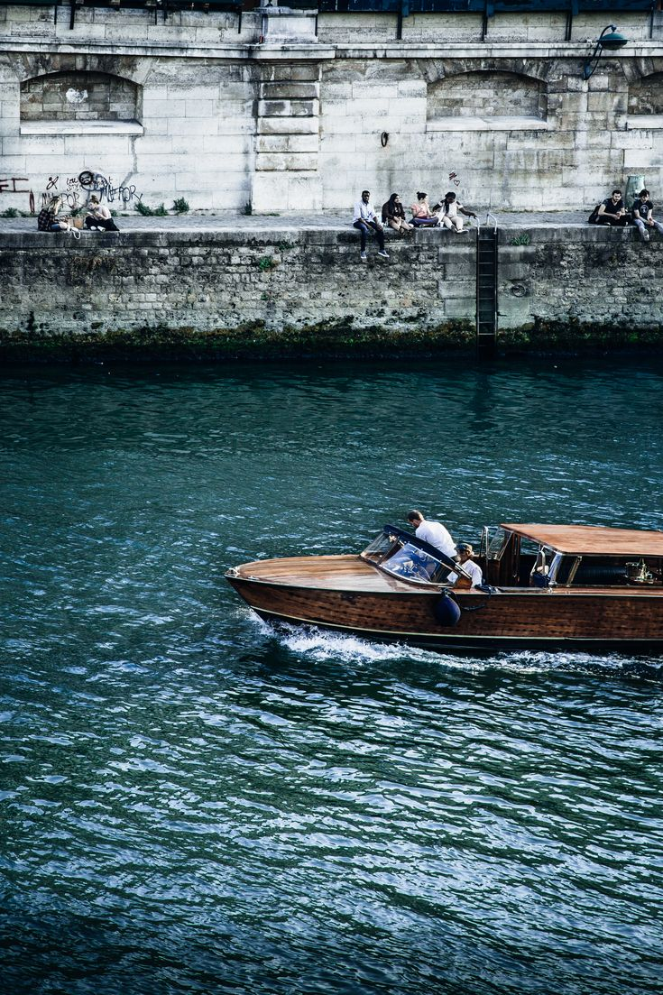 The Ultimate Paris, France Travel Guide: All the Must See Instagram, Travel Photography, Food, Cafes, Things to do, and Shopping Spot plus Travel Tips for the First Time Visitor! wooden boat on the seine #travel #paris #france