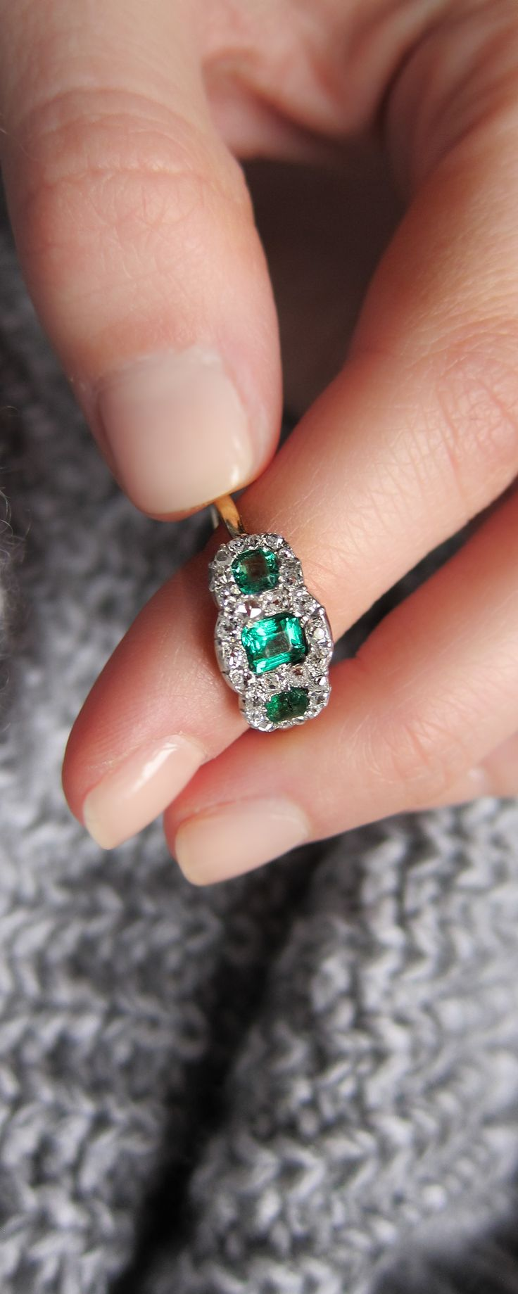 This three stone antique victorian ring is made in PLATINUM on gold with three perfectly green emeralds encircled by diamonds. This ring is classic french vintage, a lovely alternative engagement ring or an everyday piece either way it's a stunner.