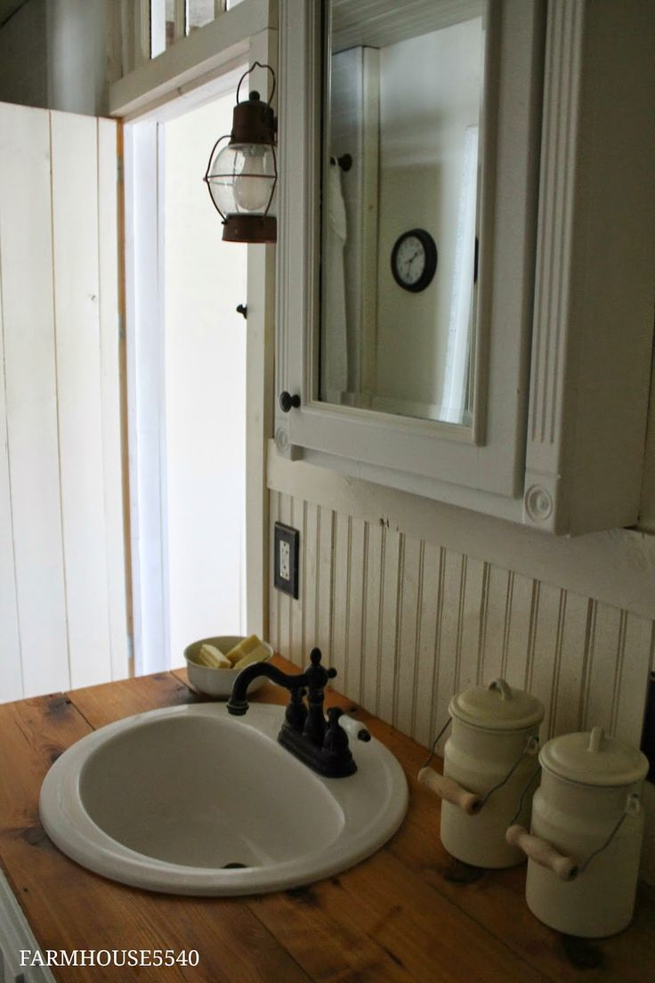 What I love about this bathroom: Wood counter and floor, antique transom over the door, white built-in-looking cupboards, beadboard... - via FARMHOUSE 5540