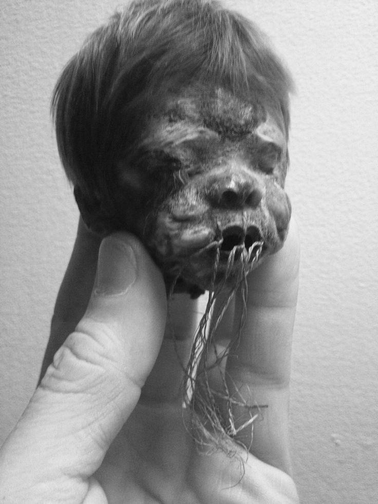 Rare shrunken head of a child. www.RealShrunkenheads.com SOLD!