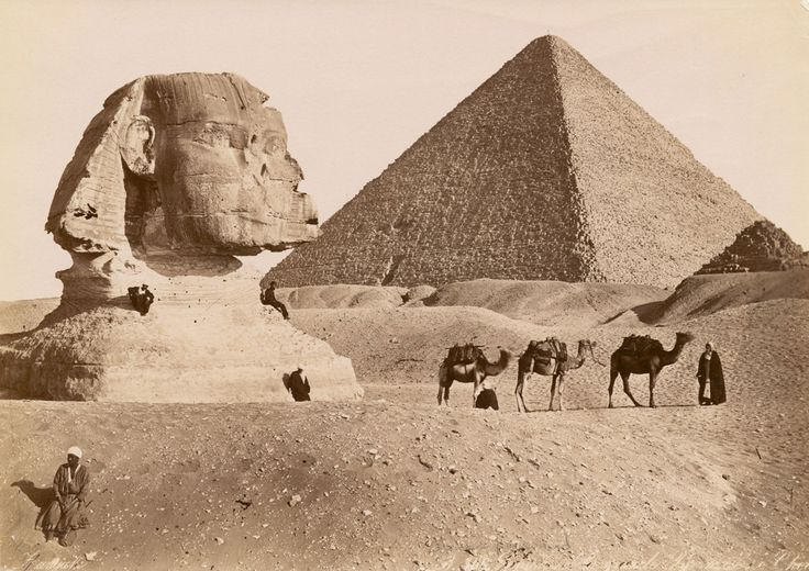 In this vintage photo taken some time between 1860 and 1929, we see the Great Sphinx of Giza with the Pyramid of Khufu in the background.