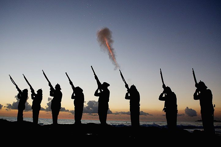 Gold Coast, Australia: Members of the Albert Battery shoot a volley of fire during the Anzac dawn service at Currumbin Surf lifesaving club. Anzac Day marks the anniversary of allied Australian and New Zealand forces landing on the Gallipoli peninsula during the first world war, and honours those who fought and died in all wars