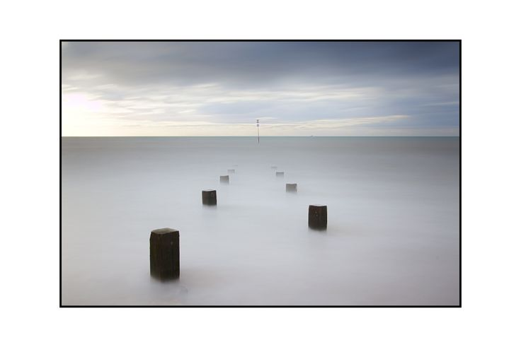 Focus on the composition of the Groynes, I like this one, considering the first shot in this series shows the drama of the scene this one belies what the day was actually like..