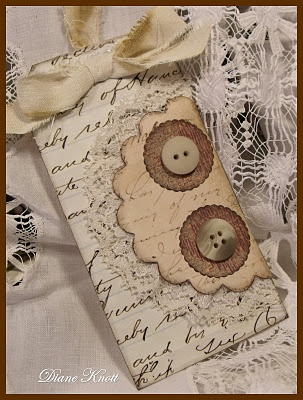 Vintage tag Aged papers, buttons, a bit of lace and torn linen for the tie....from the studio of Diane Knott