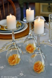 "Elegant little candle ""holders"" ...Clever, simple and pretttttttty cheap if you already have a nice set of wine glasses."