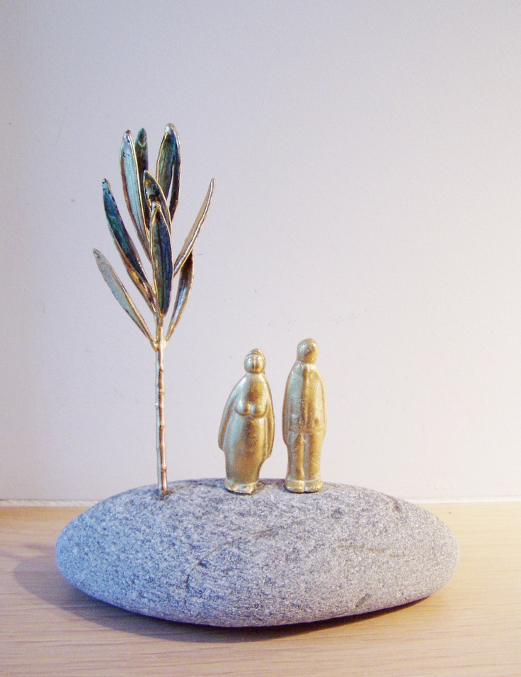 Greek olive tree with man woman figures, solid brass small  sculptures with real olive branch on large stone.