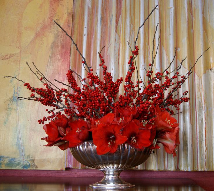 Carolyne Roehm's blog on holiday decorating and her use of saturated red monochromatic florals with silver inspired this centerpiece of amaryllis and ilex berries against a backdrop of a favorite abstract painting in my dining room. #How do you holiday?