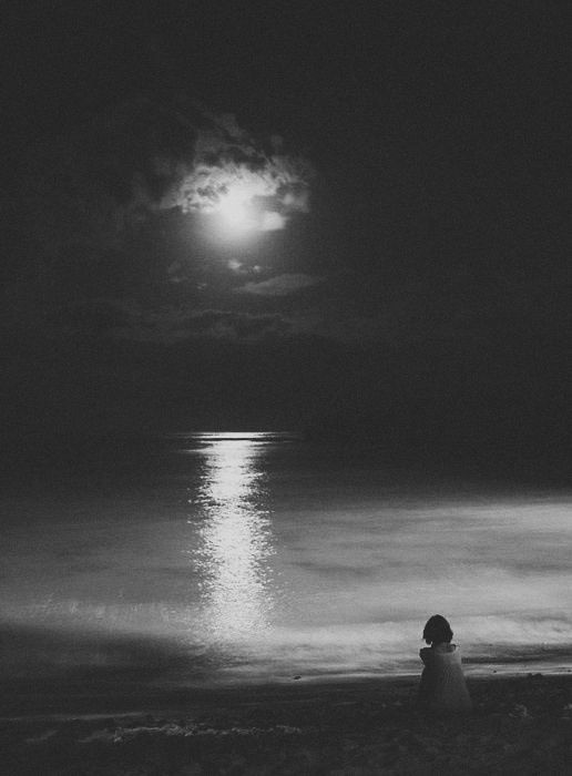 Night ocean with moon and moonlight reflection on water. Solitude. Photo by © Polina Nefidova. Original in colour. °