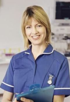 What do ward and hospital nurses wear in teh UK?     Is it still this:        Scrubs? or is it dependent on the trust you work for?