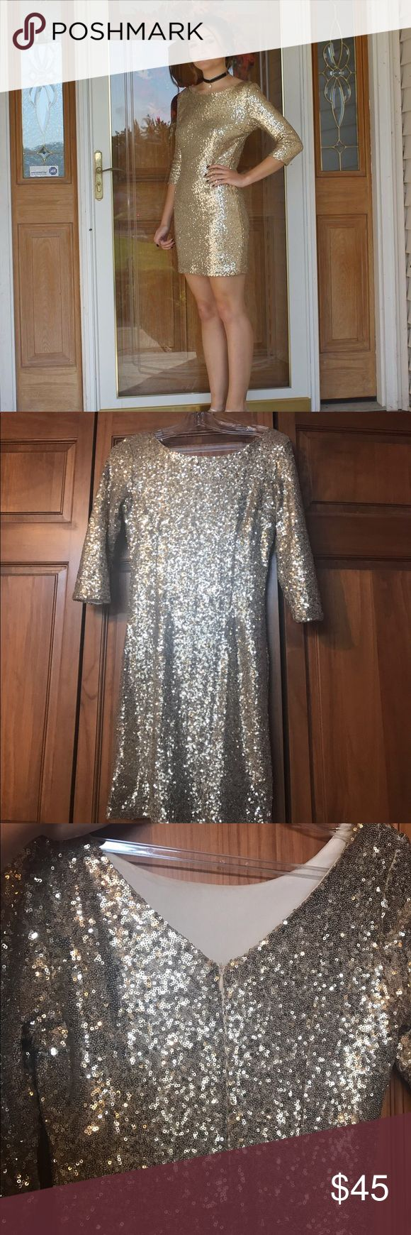 Gold Cocktail Dress Only worn once at my homecoming. This dress is very stunning and makes your eyes sparkle. It sparkles in every room. My boyfriend said he was blinded when I walked in..lol! This dress accentuates your curves and is fun to dance in. Very cute for almost any occasion! Dresses Mini
