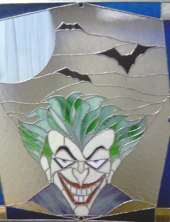 For David, who loves comics, and Jen, who loves stained glass bats.  A perfect union!  Unique Stained Glass Joker Clown and bat Moon by SDGlassCreations, $465.00