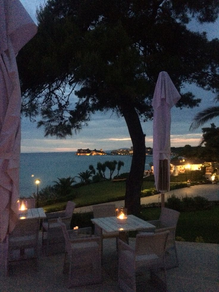 A beautiful sunset, admired from the pool bar of the Sani Beach Club