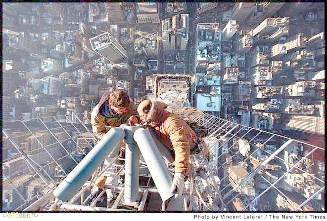 NYC. Workers at the top of the top of the Empire State Building  // by Vincent Laforet