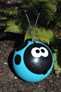 bowling ball garden art Would be so cute in red and black