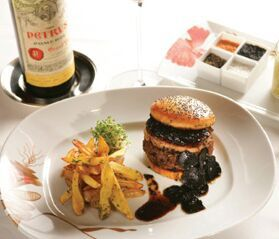 FleurBurger 5000.  $5,000 at Fleur de Lys, Chef Hubert Keller's restaurant in Mandalay Bay.  Kobe-beef burger topped with foie gras, black truffles, and Keller's secret sauce, that go inside a brioche bun.  Pray for a few great rounds of BlackJack to afford this one...