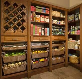 Amazing walk-in pantry. Add a counter for appliances and this would be perfect.