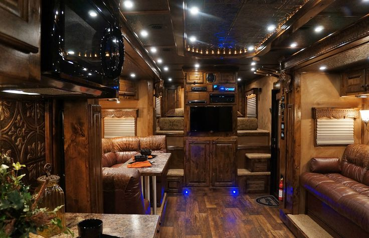 Outlaw Conversions- custom sofa sleeper and large booth, flat screen tv with home theater system, custom ceiling insert with aged tin and rope lights and double slide out! Build your own with CSTK Custom Trailers in OKC!  LQ trailer, living quarters trailer, horse trailer, conversion company, dark wood