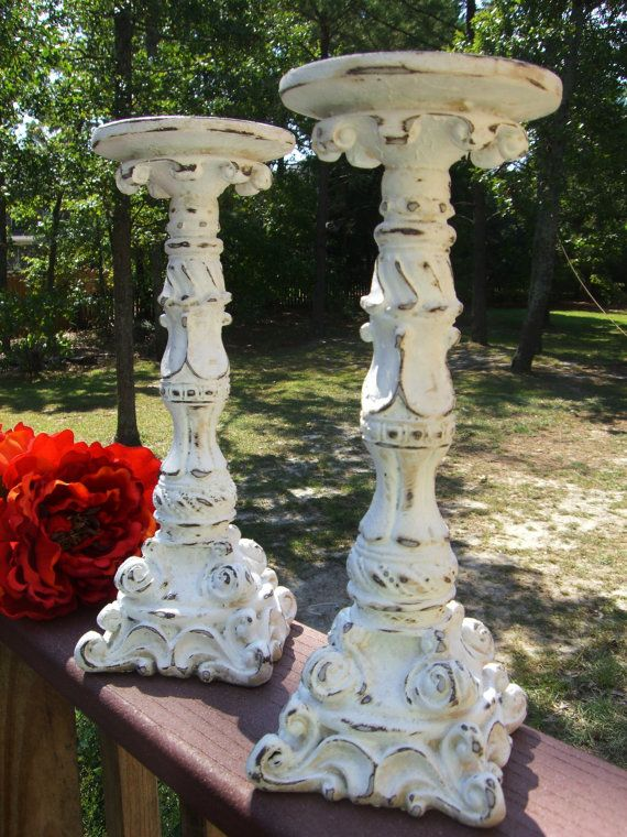 Distressed vintage candlesticks. I have a set of stained modern wood candlesticks, carved ornately like this. I've been thinking of painting them white and distressing them to look old.