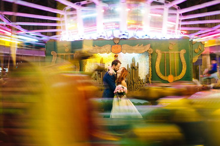 """Max and Kristen were married at the groom's family home, followed by their reception at a local amusement park! """"We have a love for 50s fashion and general art and design aesthetics"""", said the bride. """"Lakeside Amusement Park supplied an art deco flare and an offbeat reception venue that we had always dreamed of having as a backdrop to our celebration."""""""
