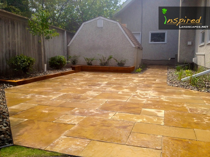 A rarely used limestone paving stone and custom timber raised planting bed. Visit www.inspiredlandscapes.net for more from us!