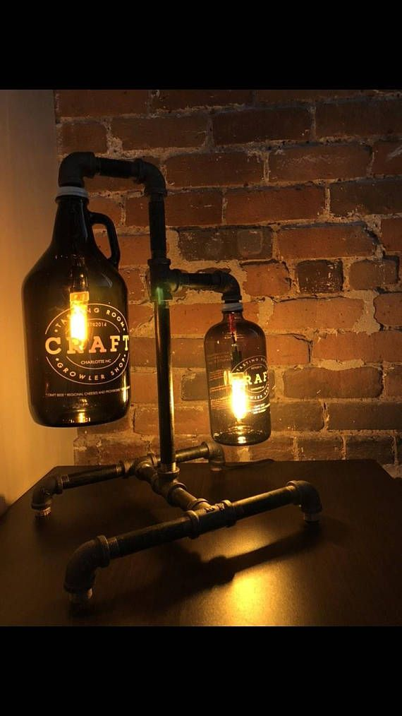 Growler lamps built from black steel pipe, UL listed electrical components, and LED light bulbs. The design is completely customizable and the growler/bottle is 100% your choice! Pricing starts at $125 for a single growler/bottle and goes up ~$50 from there. So a double (shown in my pictures)